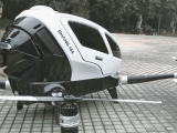 This drone can carry a human passenger and is controlled by a microsoft surface - onmsft. Com - january 7, 2016
