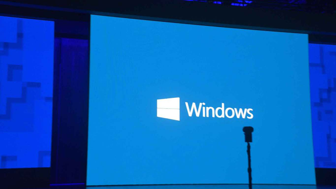 A white Windows logo on a blue background