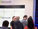 People standing in front of a Microsoft sign